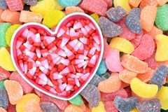 Candy corn. In heart shape bowl for Valentine Day royalty free stock photo