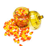 Candy Corn in Jar. Lots of candy corn in and around a pumpkin-shaped glass jar Stock Photography