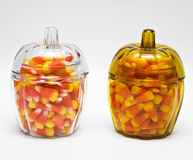 Candy Corn in Jar. Lots of candy corn in pumpkin-shaped glass jars Royalty Free Stock Photos