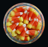 Candy Corn Jar. A top down view of a candy jar filled with candy corn against a black background Royalty Free Stock Images