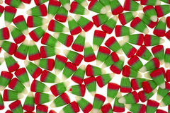 Candy corn layer. A layer of green red and white candy corn against a white background royalty free stock photo