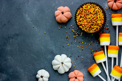 Candy corn marshmallow pops, sugar sprinkling and candy pumpkin Royalty Free Stock Images