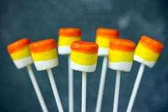 Candy corn marshmallow pops - treat on Halloween party Stock Photos