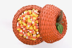 Candy Corn In Pumpkin Basket Stock Photo