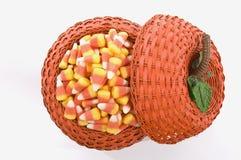 Candy Corn In Pumpkin Basket Stock Photo