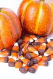 Candy Corn and Pumpkins. On a white vertical background stock images