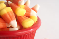 Candy Corn in a Red Bowl. Lots of candy corn in a red bowl royalty free stock images