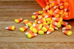 Candy Corn Spilling Out of a Pumpkin royalty free stock images
