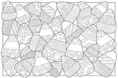 Candy corn sweets  coloring page. Candy corn with ornament. Halloween coloring page. Candy corn background. Sweet kernel with patterns. Halloween coloring book Stock Images