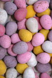 Candy covered chocolate eggs. Abstract photo of candy covered chocolate eggs Royalty Free Stock Photo