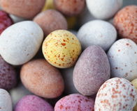 Candy covered chocolate eggs Royalty Free Stock Image