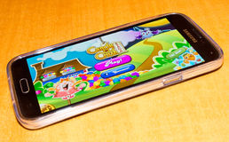 Candy crush game on phone. ZAGREB , CROATIA - 04 FEBRUARY 2015 - close up of Candy crush saga game application on samsung galaxy smartphone, product shot Royalty Free Stock Photos