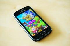 Candy Crush Saga game. On a Samsung smartphone Royalty Free Stock Image