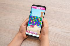 Free Candy Crush Saga Puzzle Video Game On Modern Smart Phone In Kid Hands Close-up Royalty Free Stock Photo - 165363995