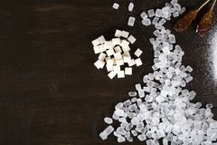 Candy and cube sugar with space for text on a wooden surface. royalty free stock image