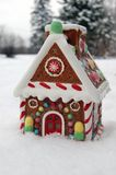 Winter Christmas picture. Gingerbread house with snow stock photography