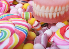 Candy and denture - Cavity problem concept Stock Images