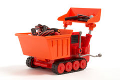 Candy digger. Toy digger collecting and loading up liquorice candy Royalty Free Stock Images