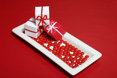 Candy Dish. A candy dish with three gift boxes Stock Photo