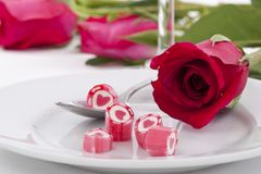 Candy on dish with rose Royalty Free Stock Images