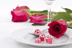 Candy on dish with rose. Valentine Series, Candy on dish with rose on white background stock image