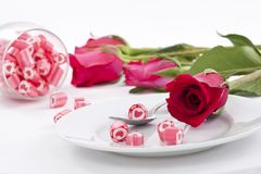 Candy on dish with rose Royalty Free Stock Image