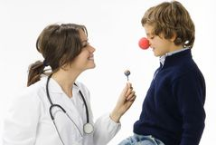 Candy and doctor. Young female doctor having a sweet approach with a little boy stock images