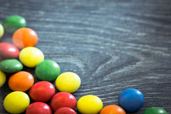 Candy dragees on wooden board Royalty Free Stock Photography