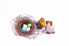 Candy Easter Eggs surround a bird's nest. Stock Images