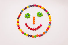 Candy Emoticon on white background. Candy emoticon, happy face colorful on white background Royalty Free Stock Images
