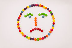 Candy Emoticon on white background. Candy emoticon, sad face colorful on white background Stock Photo