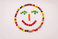 Candy emoticon on white background. Candy emoticon, smiley face colorful on white background stock illustration