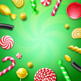 Candy flat lay. Vector candy flat lay with different sweets in red, yellow striped foil wrappers, swirl lollipops, xmas cane and copyspace top view on green Stock Photography
