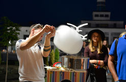 Candy floss salesmen is making candy portion Stock Images