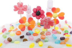 Candy flowers on candyfloss. Flowers made with different types of candy on a background of sweet cotton royalty free stock photography