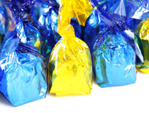 Candy in foil Stock Images