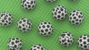 Candy footballs rotating on a green background. stock video