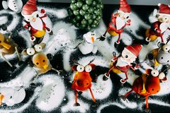 New year decor. Candy in the form of deer snowman and Santa Claus figure for new year royalty free stock photos