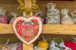 Candy in form of heart with script Ich liebe Dich. With other delicious sweet things on Valentines Day Stock Photo
