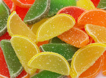 Candy frame. Yellow red green and orange fruit candy background stock photos