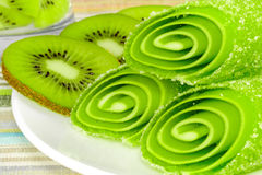 Candy fruit with slices kiwi on a plate Royalty Free Stock Photos