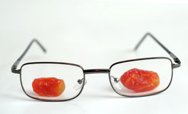 Candy fruits behind the glasses Stock Photos