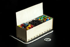 Candy Gift Box. Candies in a gift box on a black background royalty free stock photography