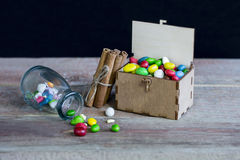 Candy Gift Box. Candies in a gift box on a wooden background royalty free stock photo