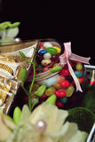 Candy gift presentation in a black background. Candy as a wedding gift in a dark background Royalty Free Stock Image