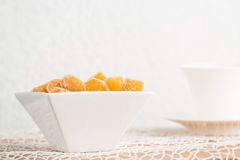 Candy ginger in white porcelain bowl Stock Image