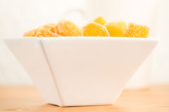 Candy ginger in white porcelain bowl Royalty Free Stock Photo