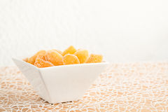 Candy ginger in white porcelain bowl Stock Images