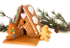 Candy gingerbread house. Candy decoration on an isolated gingerbread house stock photography
