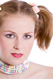 Candy girl. Pretty girl with candy around her neck and in her hair Royalty Free Stock Images